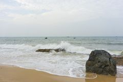 Mui Ne beach, Vietnam, a beautiful beach with long coastline, silver sand and huge waves, in an early morning Stock Photography