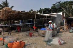 Mui ne fishing village. A boy was kniting his fishing net In mui ne fishing village stock photo
