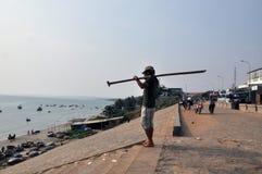 Mui ne fishing village. A fishman In mui ne fishing village royalty free stock photo