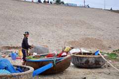Mui ne fishing village. A boy was kniting his fishing net In mui ne fishing village Royalty Free Stock Images