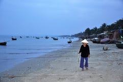 Mui ne fishing village. An old woman In mui ne fishing village stock photos