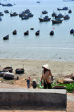 Mui ne fishing village. In mui ne fishing village a fisherman was geting off work Royalty Free Stock Image
