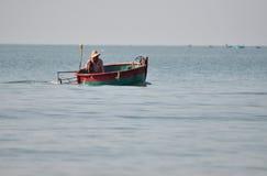 Vietnamese fisher fishing in Mui Ne, Vietnam Stock Image