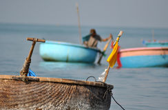 Vietnamese fisher fishing in Mui Ne, Vietnam Royalty Free Stock Photography