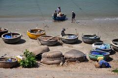 Vietnamese fisher fishing in Mui Ne, Vietnam Royalty Free Stock Image