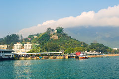 Mui Wo Ferry pier under hill Royalty Free Stock Images