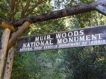 Muir Woods Forest Hiking Path Sign. Muir Woods National Monument Park, photo of hiking path sign with redwood tree and foliage in the beautiful redwood forest Royalty Free Stock Images