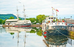 Muirtown Marina, Inverness. Muirtown Marina Inverness , part of Caledonian Canal,  with the training ship TS Royalty and the house boat Loch Ness berthed Stock Images