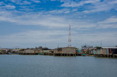 Muisne, Ecuador - March 16, 2016: Muisne town as seen from water, modest wooden houses sitting on poles waterfront Royalty Free Stock Photography