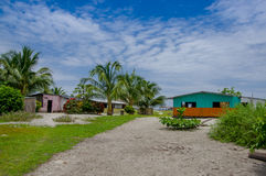 Muisne, Ecuador - March 16, 2016: Very picturesque property with some modest houses and ocean visible in background.  stock photography