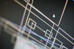 Muiswijzer onder vele lagen op monitor Stock Afbeeldingen