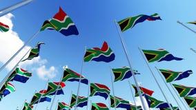 Muitas bandeiras de África do Sul contra o céu azul nebuloso ilustração stock