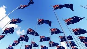 Muitas bandeiras de Austrália que acenam no vento contra o céu azul ilustração stock