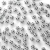 Muitas bolas de futebol em uma superfície branca Imagens de Stock Royalty Free