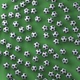 Muitas bolas de futebol em uma superfície verde Imagem de Stock Royalty Free