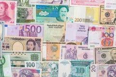 Muitas cédulas diferentes da moeda do país do mundo Fotos de Stock