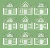 Muitas casas sob a forma de um ornamento Imagens de Stock