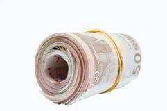 Muitas cinqüênta contas dos euro amarraram a faixa de borracha Fotos de Stock Royalty Free