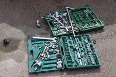 Muitas ferramentas para o carro que repara no asfalto Foto de Stock