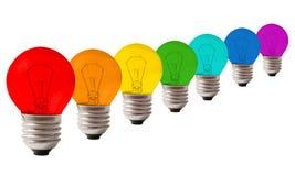 Muitas lâmpadas da cor do arco-íris, colagem Foto de Stock