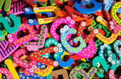 Muitas letras coloridas do alfabeto como o fundo Fotografia de Stock Royalty Free