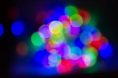 Muitas luzes obscuras coloridos verdes, vermelho, azul fotografia de stock royalty free