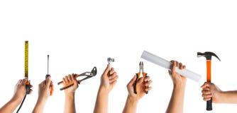Muitas mãos com ferramentas Imagens de Stock Royalty Free