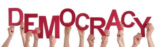 Muitas mãos dos povos que guardam a democracia vermelha da palavra Fotografia de Stock Royalty Free