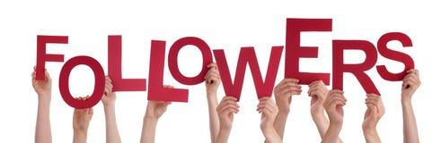 Muitas mãos dos povos que guardam seguidores vermelhos da palavra imagem de stock royalty free