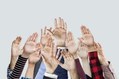 Muitas mãos levantadas junto Imagens de Stock