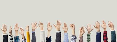 Muitas mãos levantadas junto Imagem de Stock Royalty Free