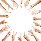 Muitas mãos no círculo com gestos diferentes Fotos de Stock