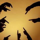 Muitas mãos que apontam adiante ou para fora no fundo alaranjado Fotografia de Stock Royalty Free