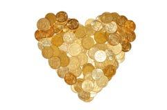 Muitas moedas como o símbolo do coração isoladas no branco Fotos de Stock Royalty Free