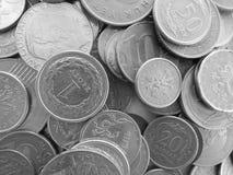 Muitas moedas de países diferentes fotografia de stock