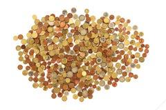 Muitas moedas do euro em um fundo branco Fotografia de Stock
