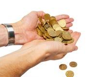 Muitas moedas nas mãos colocadas imagens de stock royalty free