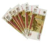 Muitas notas de banco dos rublos de 100 russos. Fotografia de Stock