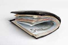 Muitas notas de banco na carteira Fotografia de Stock