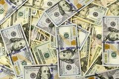 Muitas notas de dólar espalhadas para fora Imagens de Stock