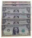 Muitas notas de dólar no fundo branco Fotos de Stock