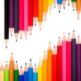 Muitas penas coloridas e uma onda Fotografia de Stock Royalty Free