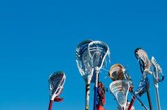 Muitas varas do lacrosse no ar Fotografia de Stock