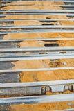 Muito perto acima da vista em trilhas do exkavator Imagem de Stock Royalty Free