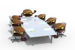 Muito a reunião do Hamburger em torno da tabela e segue seu chefe Foto de Stock