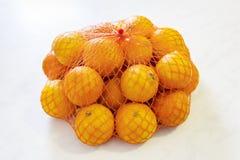 Muito tangerinas na grade Imagem de Stock Royalty Free