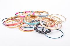Muitos braceletes no fundo branco foto de stock royalty free
