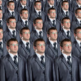 Muitos clone idênticos dos homens de negócios Fotografia de Stock