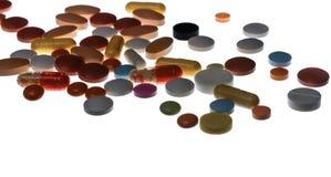 Muitos comprimidos e cápsulas coloridos Fotografia de Stock Royalty Free