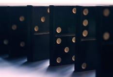 Muitos do suporte preto dos dominós Foto de Stock Royalty Free